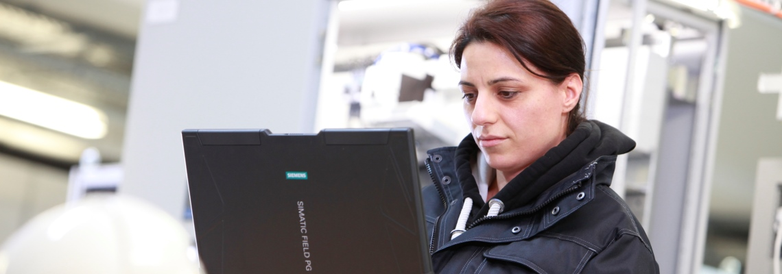 A BMA Automation employe looking at a screen